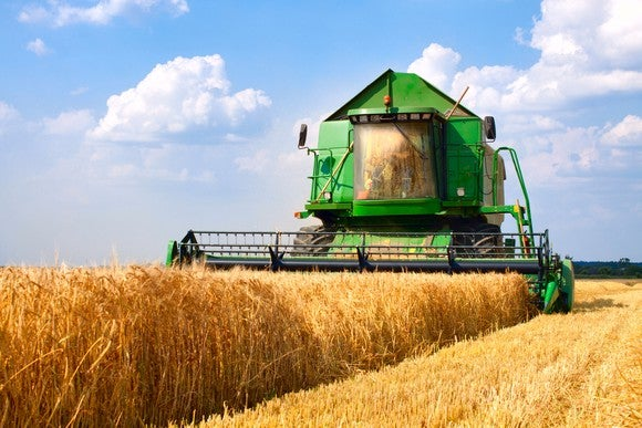 A combine harvesting crops.