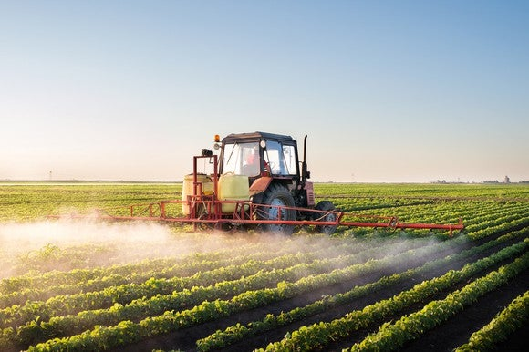 Tractor spraying a soybean field