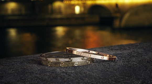 Cartier rings on a table
