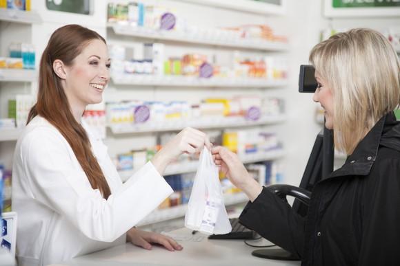 A pharmacist talks to a customer