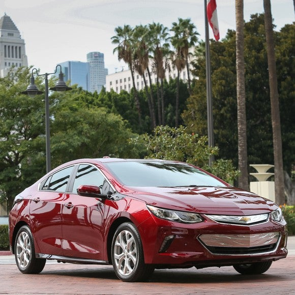 A red Chevrolet Volt sedan.