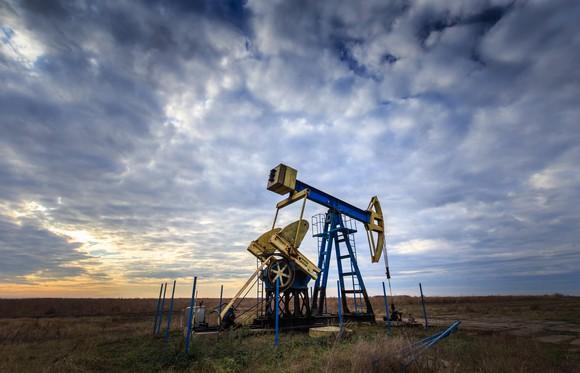 An oil pump against a cloudy sky.