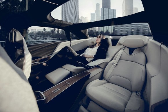 Woman reclining in Lucid Air executive seating