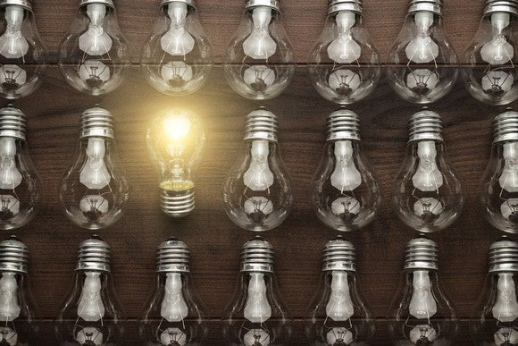Photo of a group of lightbulbs, with one lit.