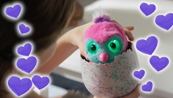 A Hatchimals toy coming out of an egg.