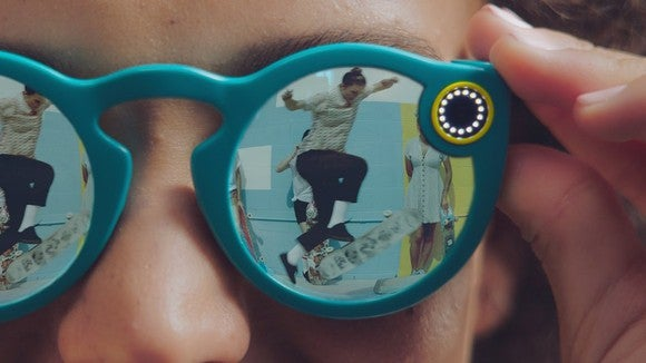 Someone wearing Snap's Spectacles watching a skateboarder perform tricks.