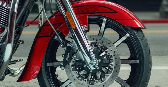 Wheel detail of Indian Motorcycle's new Chieftain Elite showing open fender and aluminum-cast wheel