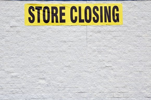 "Picture of building with a ""store closing"" sign."