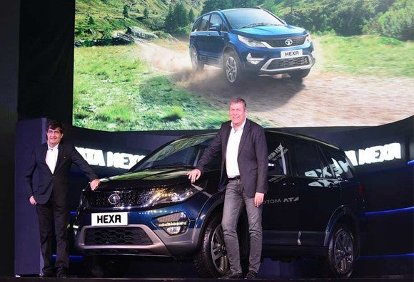 Tata Motors' Hexa, a small SUV, is shown at an auto show by company executives.