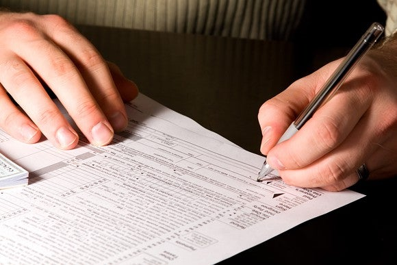 Person filling out a tax form