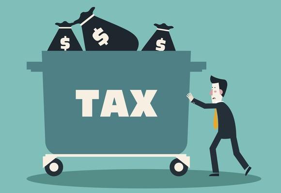 Sad cartoon man pushing cart full of money for taxes