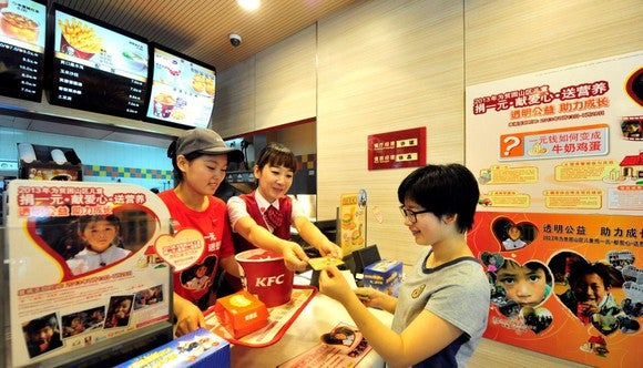 Customer picking up order at KFC in China.