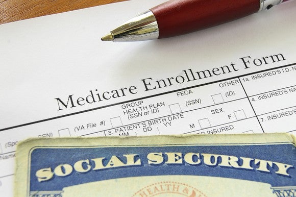 Social Security card on top of Medicare enrollment form.