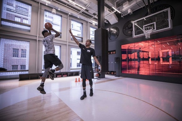 Players practice on the Nike store's basketball floor