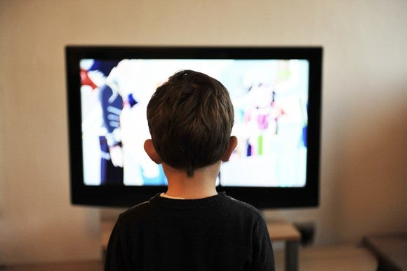 A boy watches TV