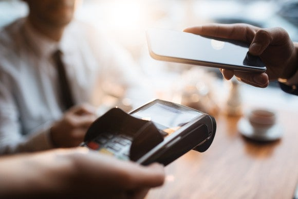 Smartphone being used to make mobile payment.