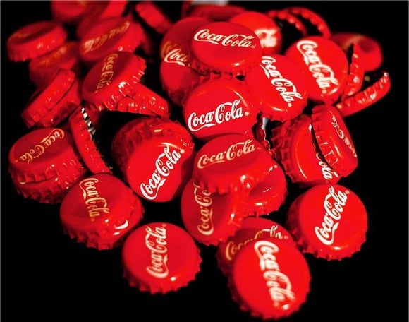 A pile of Coca-Cola bottle caps.