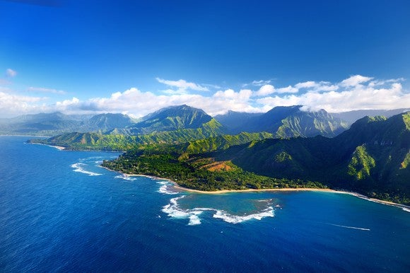 Image showing the aerial view of spectacular Na Pali coast of Kauai island, including mountains and sea.