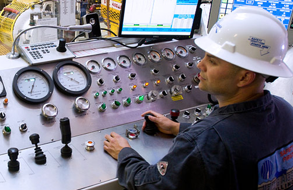 A Nabors employee in a control room.