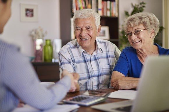 Retired couple talking with agent