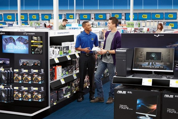 A Best Buy employee helping a customer inside a Best Buy store.