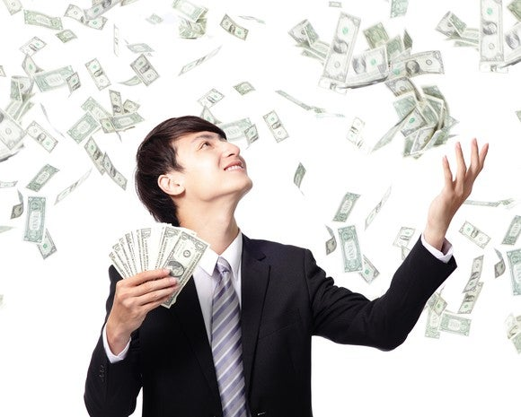 man juggling money in the air