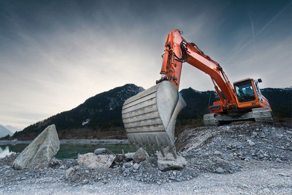 A red excavator at a mineral mine.