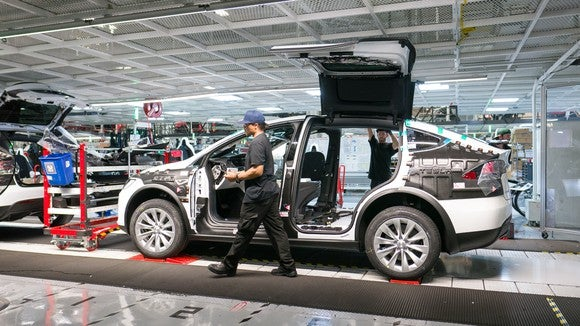 Model X being assembled in Tesla's vehicle factory.
