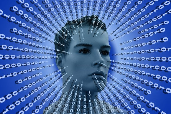 Male mannequin head surrounded by binary code.