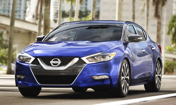 A blue Nissan Maxima sedan