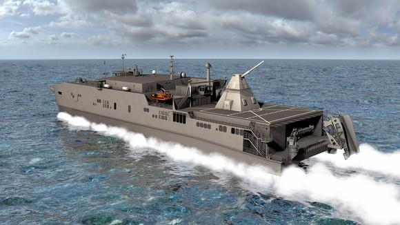 Warship carrying railgun mounted on aft deck.