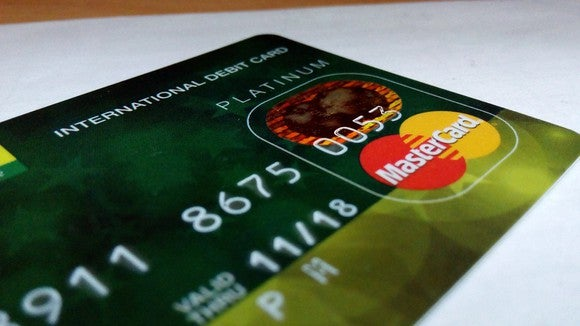 Credit card with Mastercard logo prominently displayed.