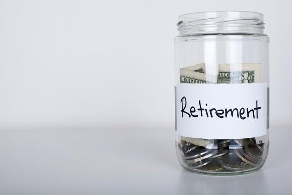 "Jar of money labeled ""retirement savings."""