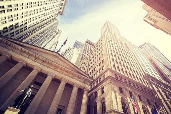 An upward view of the New York Stock Exchange from outside.