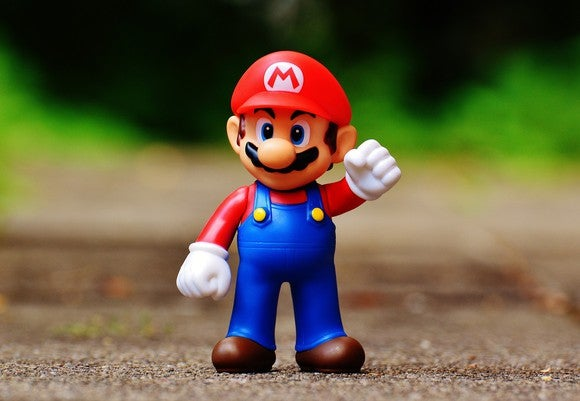 Toy figure of Nintendo's Mario character.
