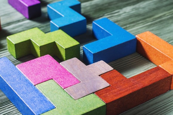 Colored wooden blocks positioned together like a puzzle.