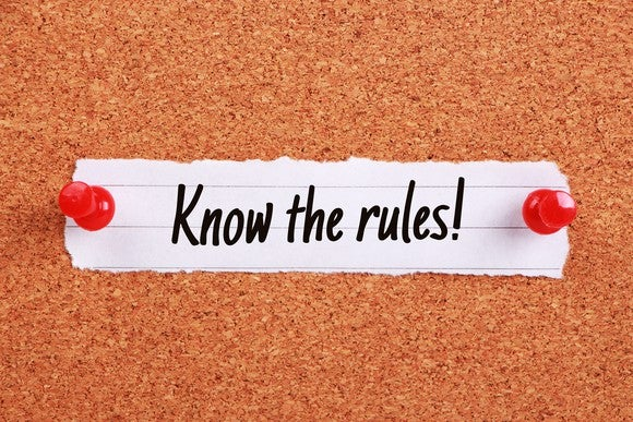 "Slip of paper pinned to corkboard, saying ""know the rules!"""