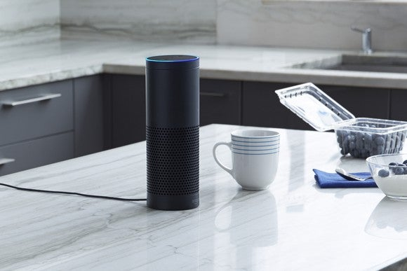 Amazon Echo device siting on a kitchen counter.