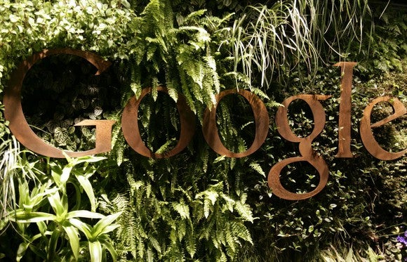 An image of Google's logo blends into the leaf-filled background on the reception desk at Google's offices in Sydney