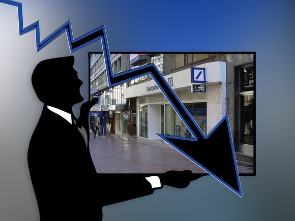 Silhouette of man standing in front of Deutsche Bank with arrow pointing down.