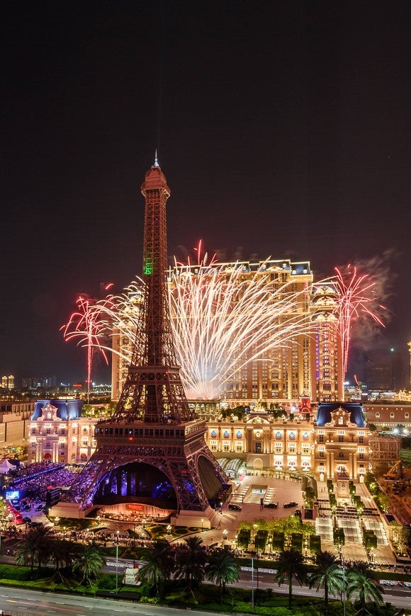 The Eiffel Tower replica at the Parisian, with fireworks behind it.