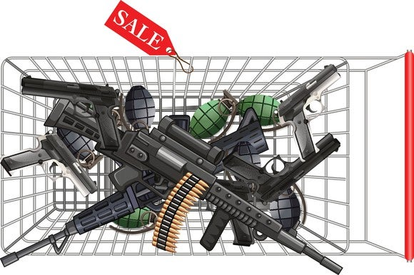Overhead view of a shopping car full of guns.