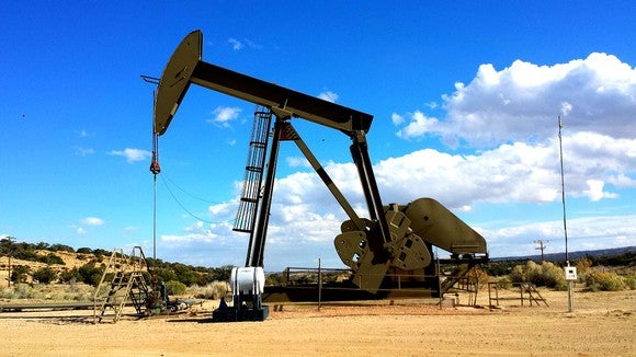 A pumpjack operating during the daytime.