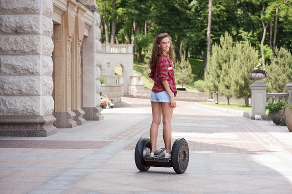 Woman on Segway looking back at camera