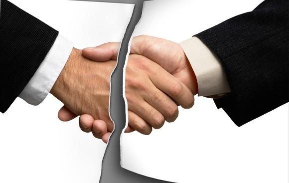 Handshake torn apart