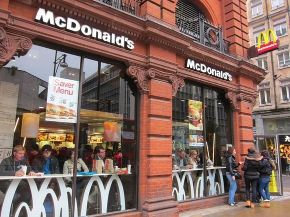 A McDonald's restaurant on a street corner