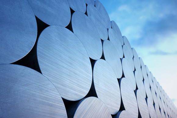 Rolls of aluminum against blue sky.