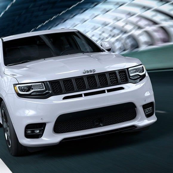 A white Jeep Grand Cherokee SRT
