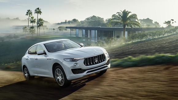 A white Maserati Levante SUV on a dirt road.