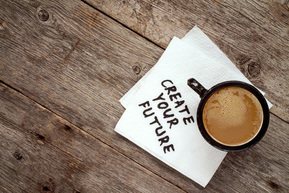 """create your future"" written on a napkin under a mug of coffee"